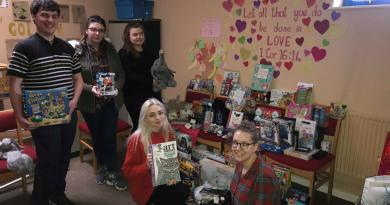 STUDENTS SET UP PRESENT DROPOFF FOR THE SALVATION ARMY