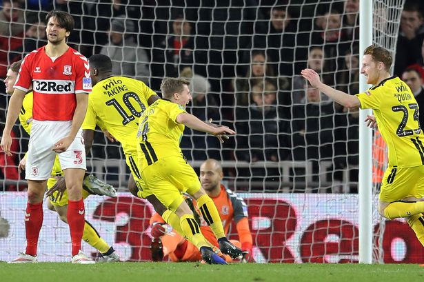 Burton Albion players celebrate Jake Hesketh's goal in the Carabao Cup Quarter-Final against Middlesbrough FC