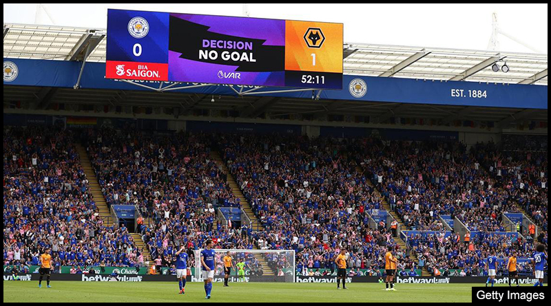 Fans are informed of the VAR decision at Leicester City's King Power Stadium