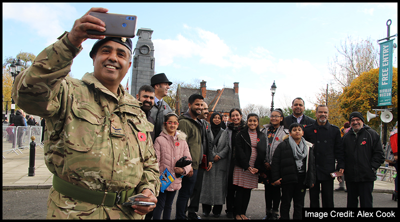Lance Corporal Sadiq posing for a selfie with members of the local BAME community after Sunday's Remembrance Service in Middlesbrough